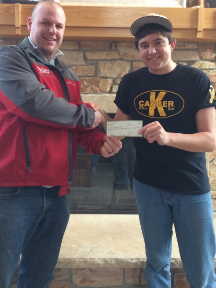 Sean receiving check from Green Acres Lawn Care & Landscaping