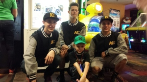 Collin, Luca, and Dustan kneeling with Tyler